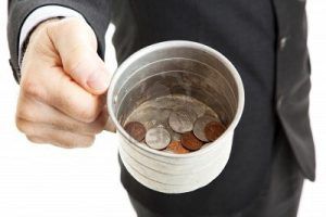 9969439-closeup-of-a-businessman-with-a-tin-cup-begging-for-change-white-background-1